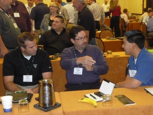 Attendees emphasizing different perspectives. Pictured are, left to right, Jon Heinen, Vermeer; Grady Bell, Laney Directional Drilling; and Adam Hamman, H&H Enterprises.