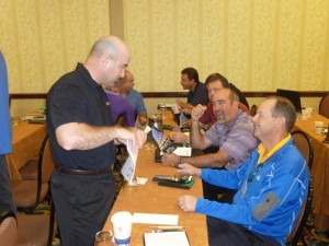 Facilitator Wally Adamchik makes a point to Kevin Miller and Scott Miller of Miller Pipelines.