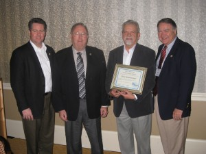 Long-time industry leader Gerry Muenchmeyer received NASSCO's highest honor when he was inducted into the Select Society of Sanitary Sewer Sleuths. Making the presentation through a light-hearted roast was a previous inductee Mike Hogan. Pictured, left to right, along with fellow Society members are: Hogan, Wally Huber, Muenchmeyer and William Shook.