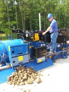 Jim Lee demonstrates the operation of a large auger boring machine.