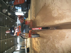 Gary Lawson of Ditch Witch demonstrates a walk-behind trenching machine.