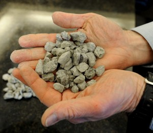 Wyo-Ben Inc.'s vice president of resources, Richard Brown, holds pieces of Wyoming bentonite that was used by NASA to calibrate the Curiosity rover on Mars.