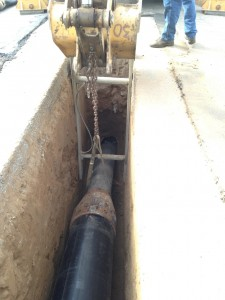 Insertion pit with Koloss 14-inch rear expander pneumatic hammer pipe bursting 15-inch VCP and pulling in 20-inch HDPE.
