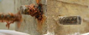 Figure 3. Corrosion on steel rebar inside Portland cement concrete after an accelerated chlorine intrusion test (left), its counterpart embedded in geopolymer concrete shows no signs of corrosion.