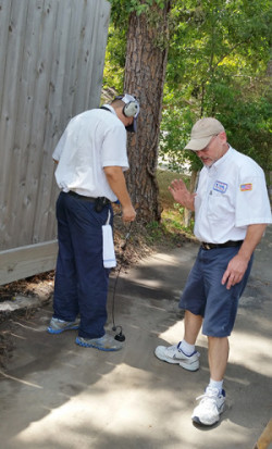 Bill Boughey of USA Leak Detection listens to the concrete and beyond